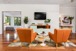 modern designed living area with two orange chairs
